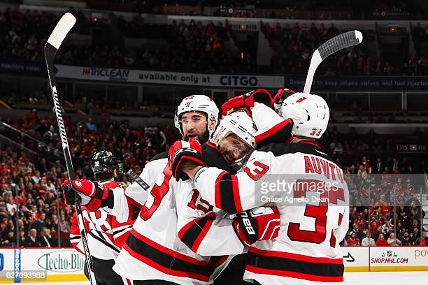 Travis Zajac of the New Jersey Devils celebrates after scoring his third goal against the Chicago Blackhawks in the third period at the United Center...