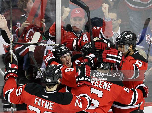 Travis Zajac of the New Jersey Devils celebrates his first period goal with Dainius Zubrus Zach Parise Mark Fayne and Andy Greene of the New Jersey...