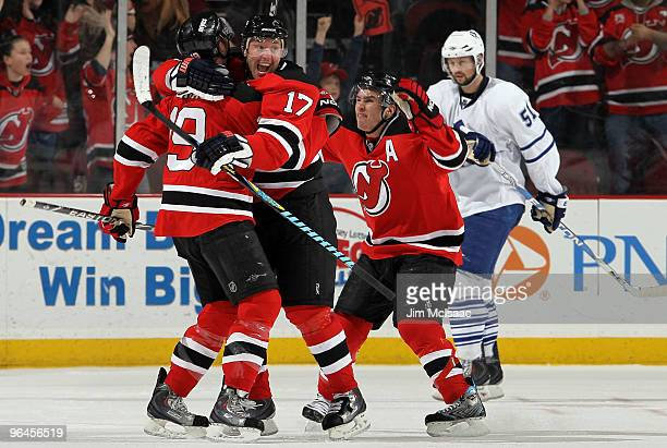 Travis Zajac of the New Jersey Devils celebrates his game tying goal in the third period against the Toronto Maple Leafs with teammtes Ilya Kovalchuk...