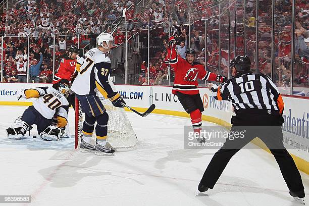 Travis Zajac of the New Jersey Devils celebrates scoring a goal against against the Buffalo Sabres at the Prudential Center on April 11, 2010 in...