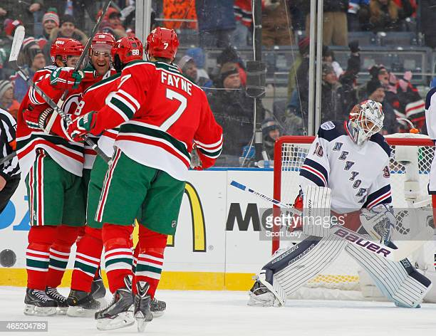 Travis Zajac of the New Jersey Devils celebrates with teammates following his first period goal against the New York Rangers during the 2014 Coors...