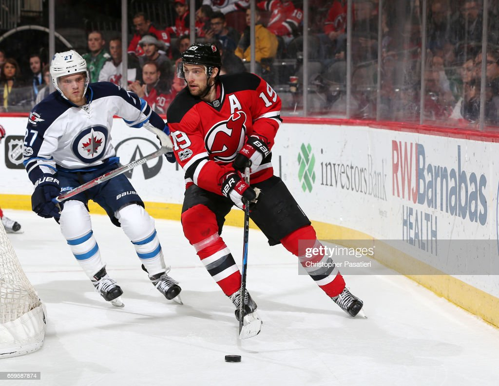 various colors e7f38 7c176 Travis Zajac of the New Jersey Devils controls the puck ...