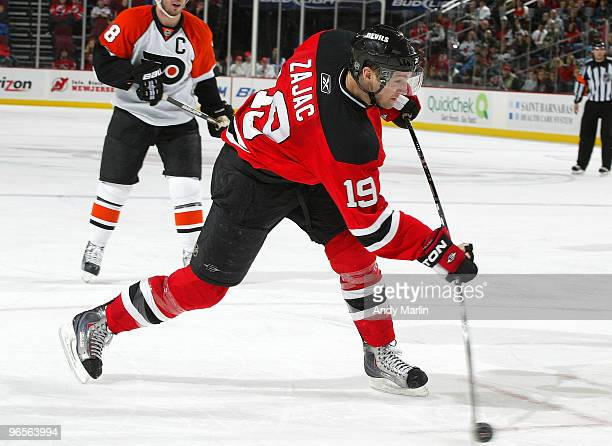 Travis Zajac of the New Jersey Devils fires a shot against the Philadelphia Flyers during the game at the Prudential Center on February 10, 2010 in...