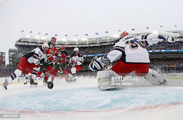 Travis Zajac of the New Jersey Devils scores a first period goal against the New York Rangers during the 2014 Coors Light NHL Stadium Series at...