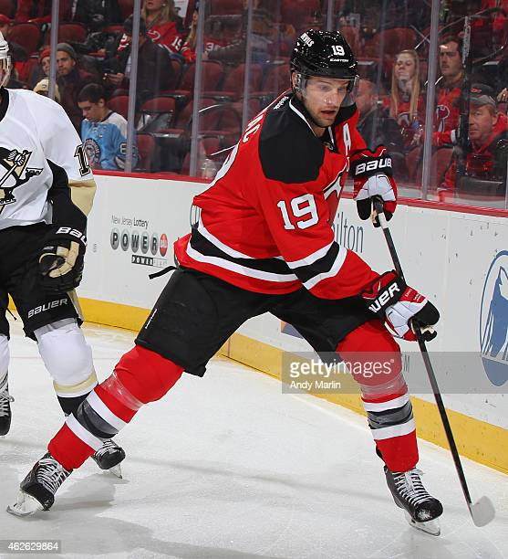 Travis Zajac of the New Jersey Devils skates against the Pittsburgh Penguins during the game at the Prudential Center on January 30, 2015 in Newark,...