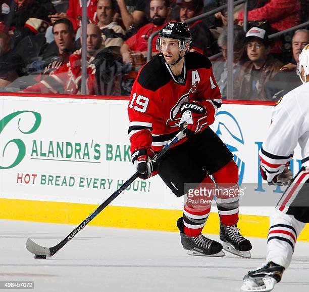 2fc522709 Travis Zajac of the New Jersey Devils skates in an NHL hockey game against  the Chicago