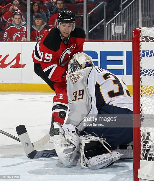 Travis Zajac of the New Jersey Devils takes the shot against Anders Lindback of the Nashville Predators at the Prudential Center on December 17 2010...
