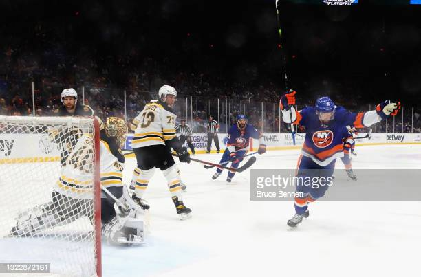 Travis Zajac of the New York Islanders scores during the first period against Tuukka Rask of the Boston Bruins in Game Six of the Second Round of the...