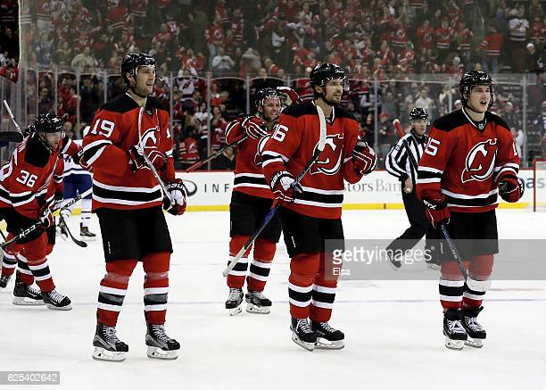 Travis Zajac,Jacob Josefson and Reid Boucher of the New Jersey Devils celebrate the win over the Toronto Maple Leafs on November 23, 2016 at...