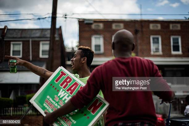 Travon Hawkins left and Nate Fleming right collect Trayon White's campaign signs for reuse after the Ward 8 Democrats' city council member straw poll...