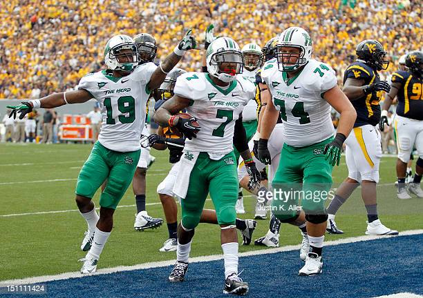 Travon Van of the Marshall Thundering Herd celebrates after rushing for a touchdown against the West Virginia Mountaineers during the game on...