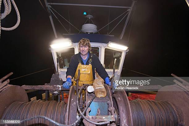 trawler fishing at night - bang boat stock pictures, royalty-free photos & images