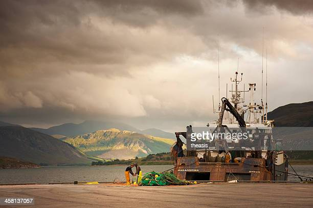 trawler in ullapool harbour - theasis stock pictures, royalty-free photos & images