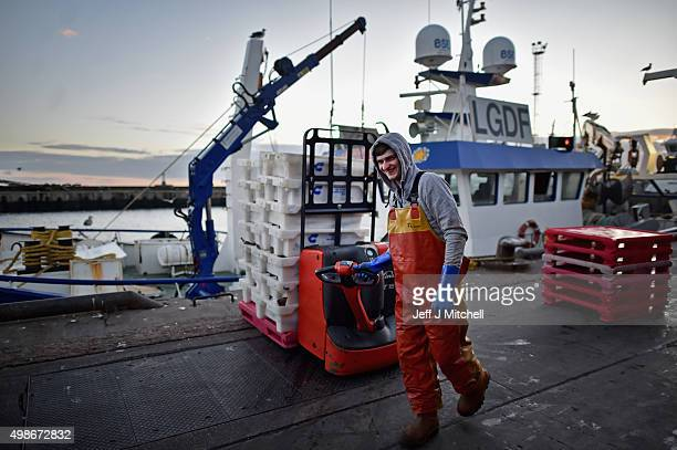 Trawler men unload their catch at Peterhead fish market for sale the following morning on November 24 2015 in Peterhead Scotland Recent negotiations...