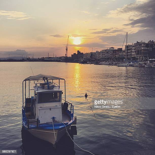 trawler moored on sea - peloponnese stock photos and pictures