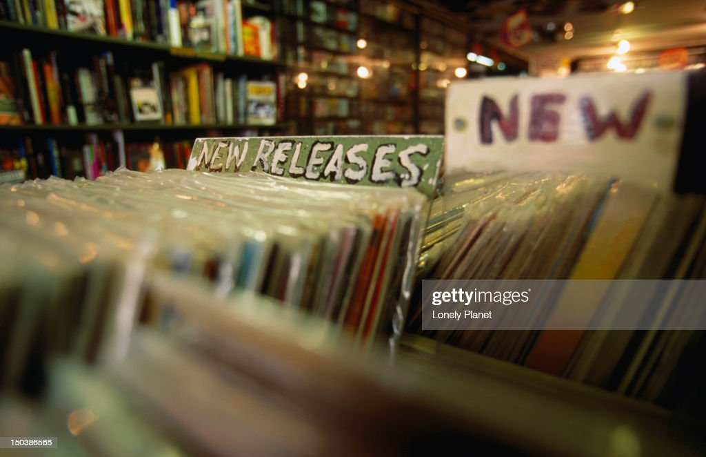 Trawling through the vinyl record new releases at 'Rocks in Your Head' music store. : Stock Photo