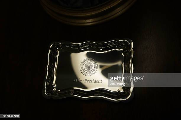 A tray engraved with the presidential seal is placed on a stand in the West Wing lobby of the White House August 22 2017 in Washington DC The White...