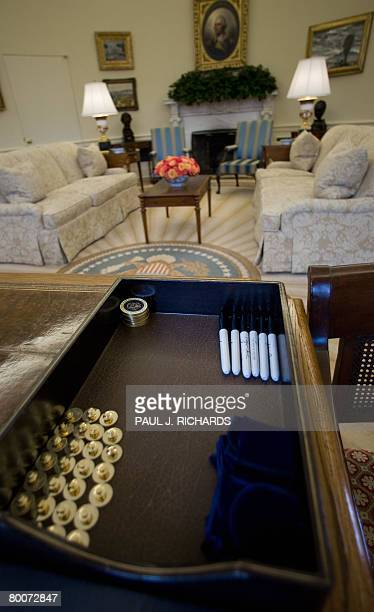 A tray full of Presidential gifts and pens to sign autographs with sits on the desk of US President George W Bush inside the Oval Office of the White...