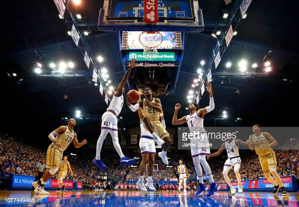 Tray Hollowell of the Wofford Terriers drives toward the basket during the game against the Kansas Jayhawks at Allen Fieldhouse on December 04 2018...