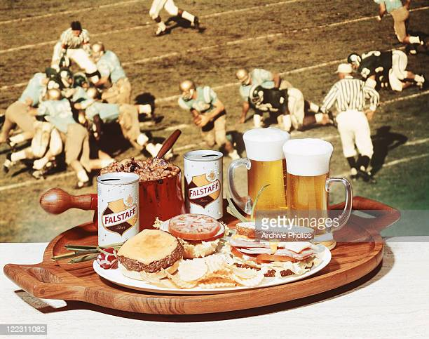 Tray of beer and snack in front of television screen