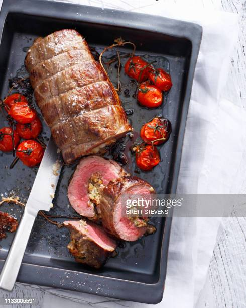 tray of braciole with tomatoes - roast dinner stock pictures, royalty-free photos & images