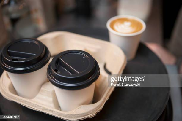 tray of coffee in disposable cups in cafe - take away food stock pictures, royalty-free photos & images