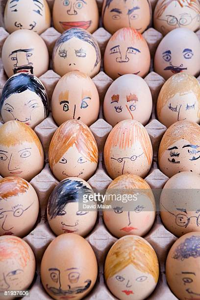 Tray of eggs with faces drawn on them