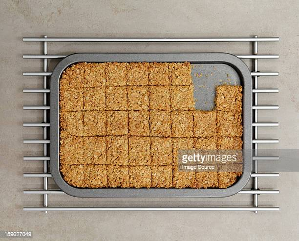 tray of flapjacks with some missing - esher stock pictures, royalty-free photos & images
