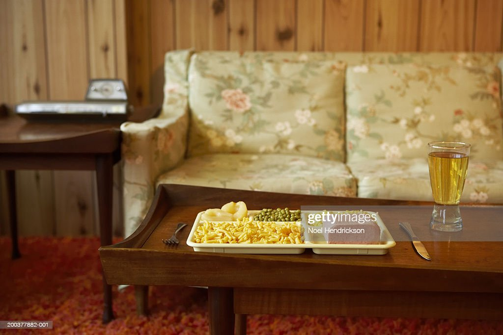 Tray of food and beverage on coffee table : Stock Photo