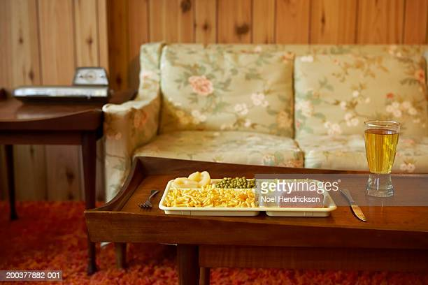 tray of food and beverage on coffee table - cibo pronto foto e immagini stock