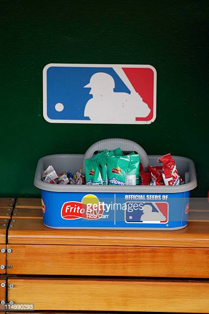 A tray of gum and sunflower seeds are shown in the Philadelphia Phillies dugout prior to the start of their game against the Washington Nationals at...