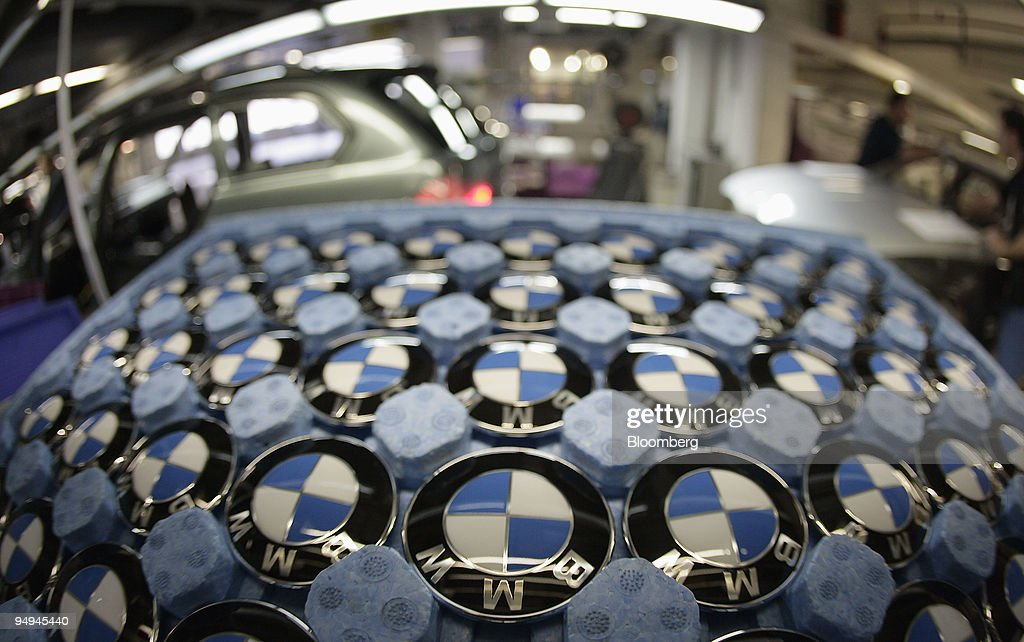 A tray of logos sit in a tray on the BMW 3-series production : News Photo