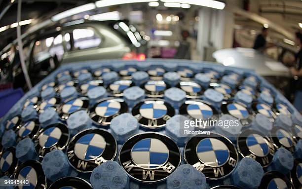 A tray of logos sit in a tray on the BMW 3series production line at the BMW factory in Munich Germany on Wednesday March 11 2009 Bayerische Motoren...