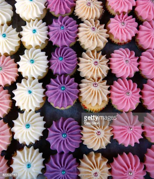 A tray of mini candied cupcakes for sale on the 'Violet' stall during the first night of Covent Garden food market on August 7 2008 in London England...