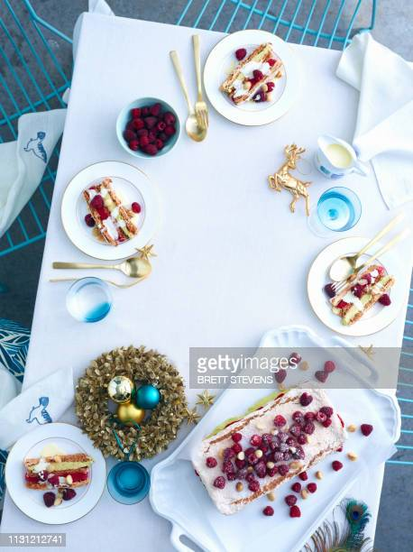 tray of raspberry macadamia vacherin layer cake on christmas table - 盛り付け ストックフォトと画像