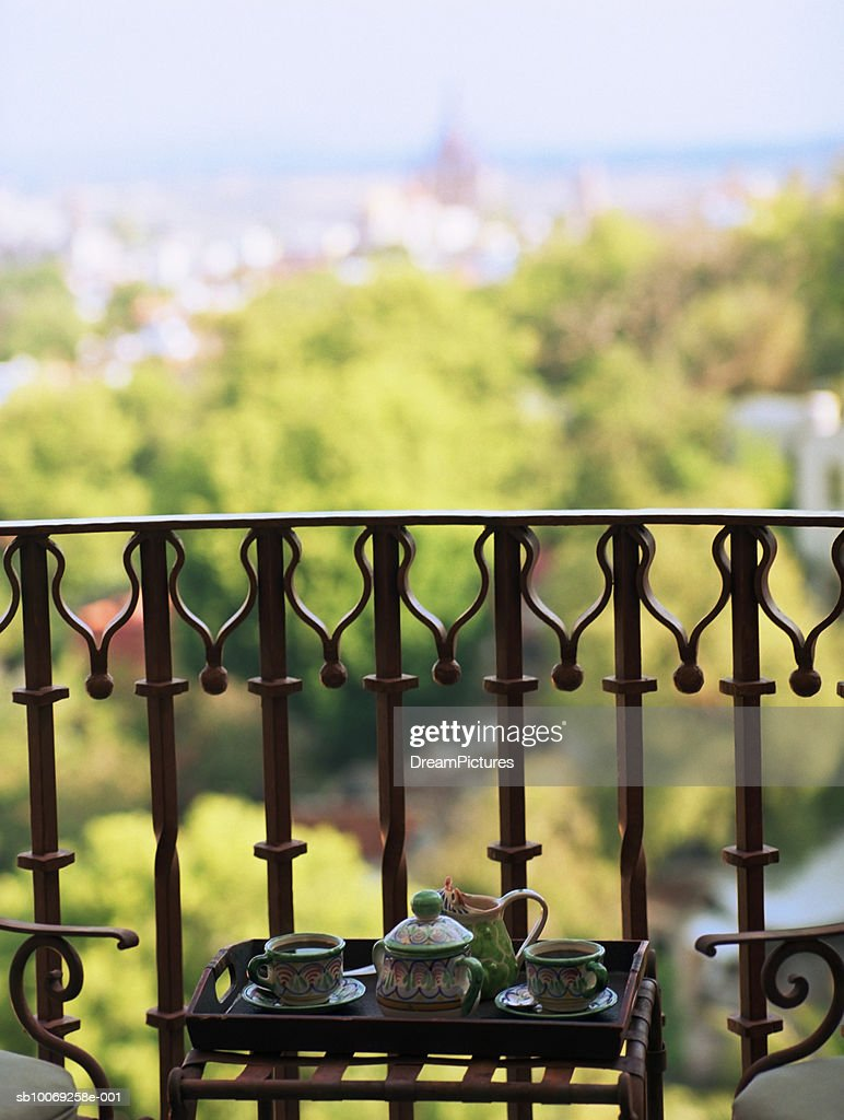 Tray of tea service on balcony : Stockfoto