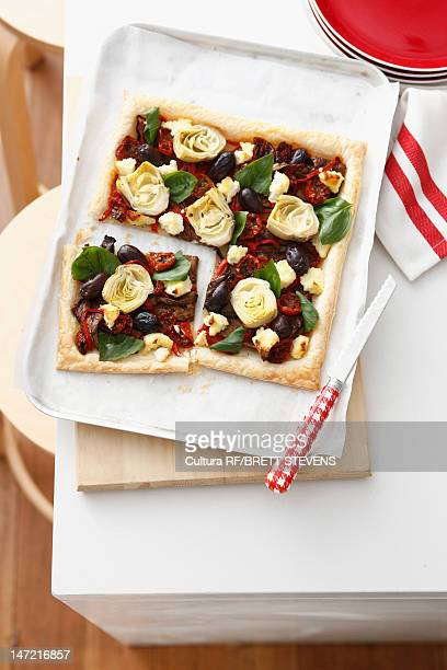 Tray of vegetable tart in kitchen
