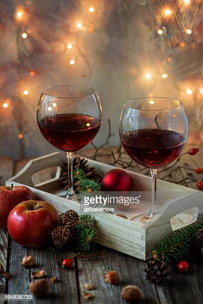 Tray with two glasses of red wine and Christmas decorations