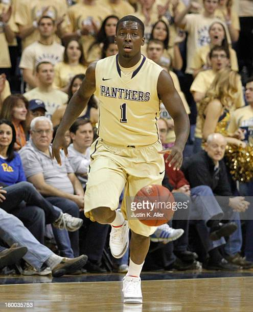 Tray Woodall of the Pittsburgh Panthers brings the ball up court against the Connecticut Huskies at Petersen Events Center on January 19, 2013 in...