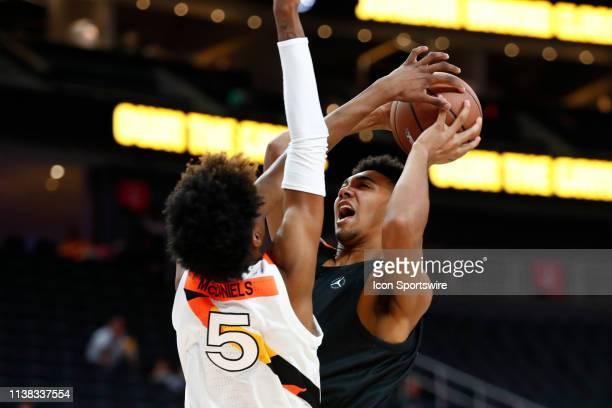 Trayce JacksonDavis JBN Away Team power forward takes a shot while being defended by Jaden McDaniels JBN Home Team power forward during The 18th...