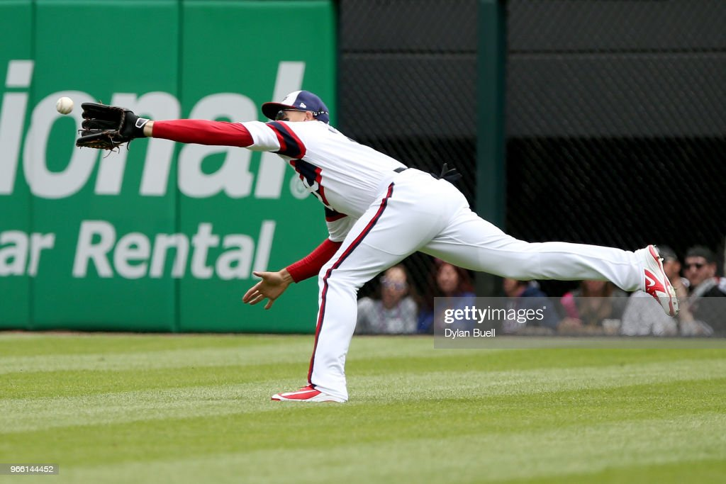 Trayce Thompson #32 of the Chicago White Sox dives to make a catch in the third inning against the Milwaukee Brewers at Guaranteed Rate Field on June 2, 2018 in Chicago, Illinois.