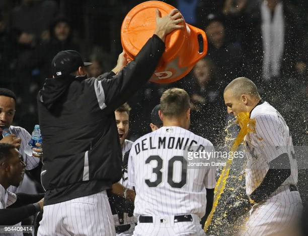 Trayce Thompson of the Chicago White Sox is doused by teammates after hitting a walkoff solo home run with two out in the bottom of the 9th inning...