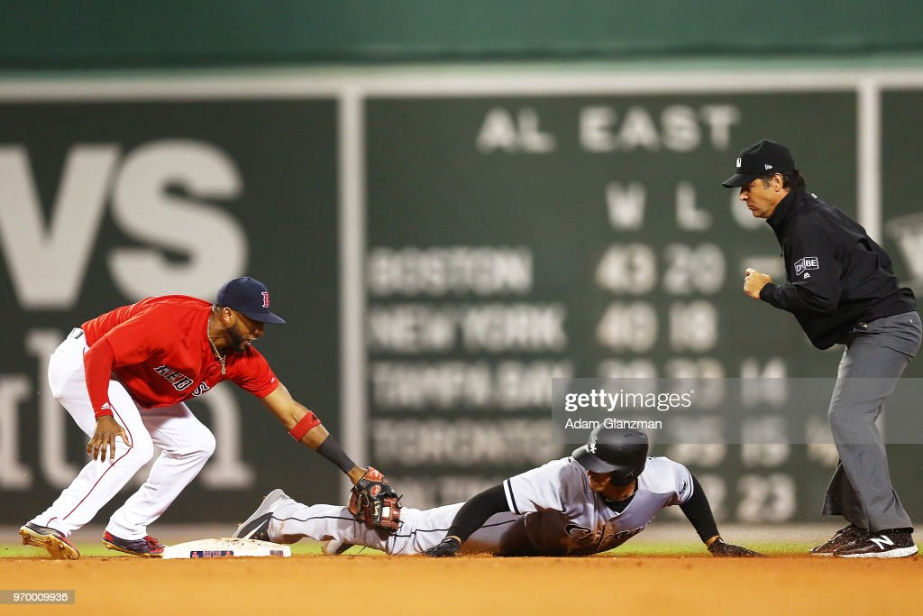Trayce Thompson #32 of the Chicago White Sox is tagged out at second base by Eduardo Nunez #36 of the Boston Red Sox in the seventh inning of a game at Fenway Park on June 08, 2018 in Boston, Massachusetts.