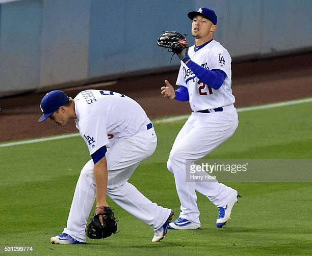 Trayce Thompson of the Los Angeles Dodgers calls off Corey Seager to make a catch for an out of Matt Carpenter of the St Louis Cardinals during the...