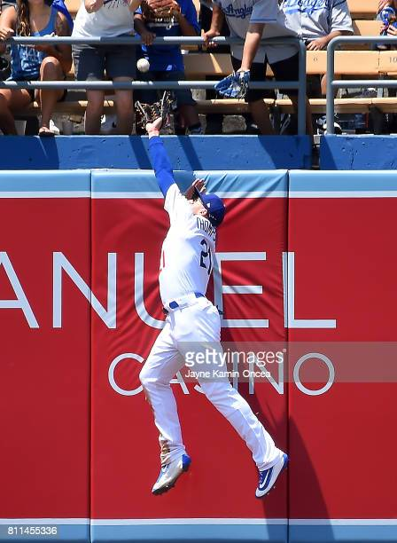 Trayce Thompson of the Los Angeles Dodgers just misses a catch on a two run home run hit by Eric Hosmer of the Kansas City Royals off Clayton Kershaw...