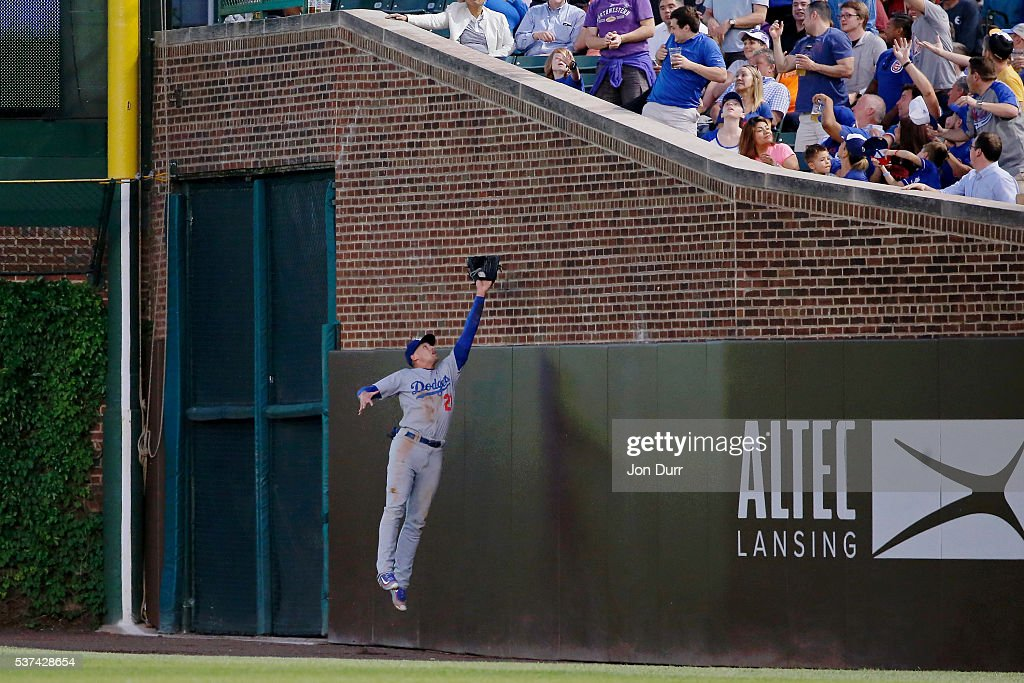 Trayce Thompson #21 of the Los Angeles Dodgers makes a leaping catch for an out against the Chicago Cubs during the fourth inning at Wrigley Field on June 1, 2016 in Chicago, Illinois.
