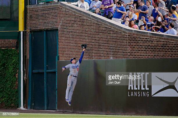 Trayce Thompson of the Los Angeles Dodgers makes a leaping catch for an out against the Chicago Cubs during the fourth inning at Wrigley Field on...