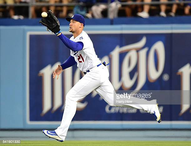 Trayce Thompson of the Los Angeles Dodgers makes a running catch for an out of Ryan Zimmerman of the Washington Nationals to end the fourth inning at...