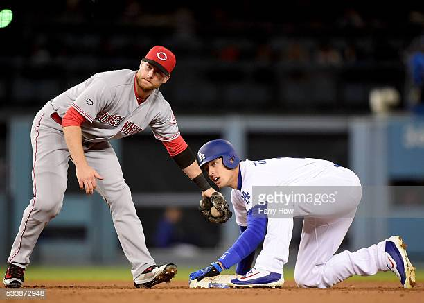 Trayce Thompson of the Los Angeles Dodgers reacts to stealing second base with Zack Cozart of the Cincinnati Reds durig the sixth inning at Dodger...