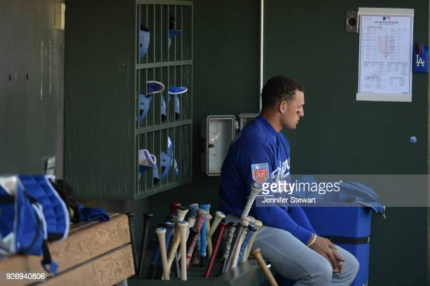 Trayce Thompson of the Los Angeles Dodgers sits in the dugout in the spring training game against the Kansas City Royals at Surprise Stadium on...